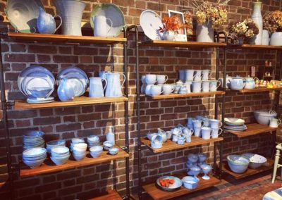 Shelves of pottery Rosemarie Durr Pottery