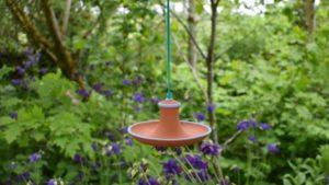 Terracotta Hanging Bird Feeder by Rosemarie Durr Pottery in Garden